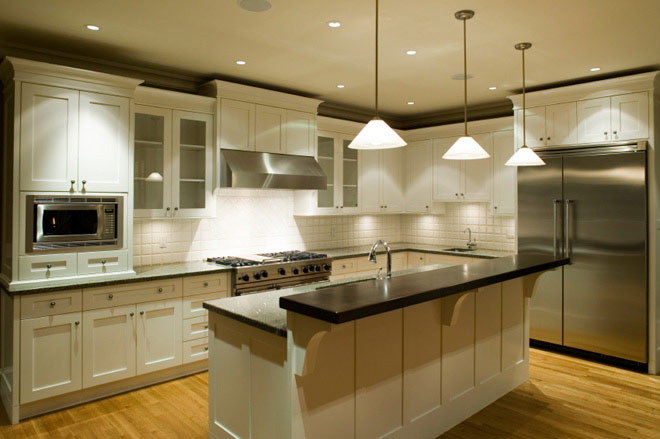 Kitchen with decorative light fixtures and stainless steel appliances